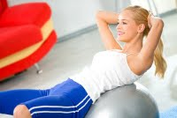 bigstockphoto_Young_Happy_Woman_Doing_Fitnes_2714322